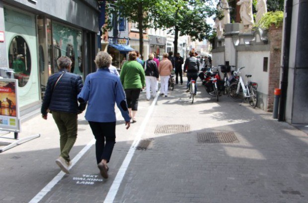 Text walking lanes introduced for phone users, Antwerp, Belgium - 12 Jun 2015